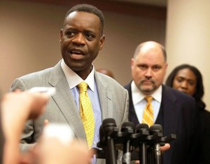 Detroit EM Kevyn Orr, with spokesman Bill Nowling, from Michigan Gov. Rick Snyder's office, at his left.