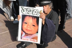 Steve Baratta holds a photo of 19-month-old Suzie Pena, who was killed by LAPD SWAT in 2005. Baratta says Pena's death was very emotional for him and further galvanized him in fighting police brutality. (Dan Bluemel / LA Activist)