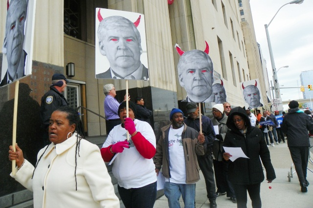 City retirees and supporters protest outside federal courthouse in downtown Detroit Oct. 28 as Michigan Gov. Rick Snyder, depicted as the devil in signs, testifies.