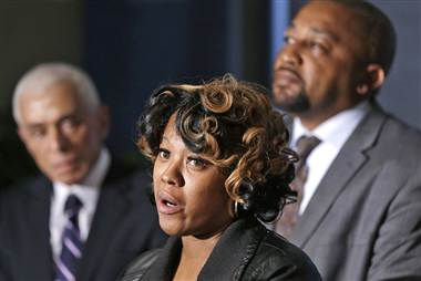 Monica McBride (center) and Walter Ray Simmons, Renisha McBride's parents, speak at press conference as family attorney Gerald Thurswell listens. Photo: Carlos Osorio/AP: