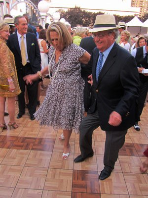 "Noreen and Kenneth Buckfire square-dancing at event in NYC they chaired: ""New York New York's a Wonderful Town."" No wonder--Wall Street's there."
