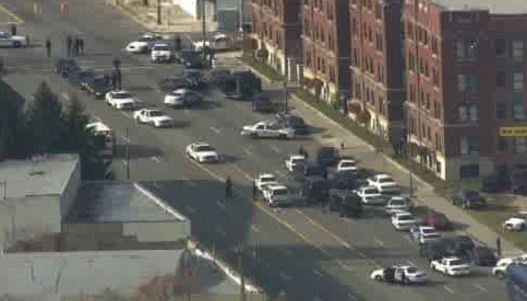 """Massive police raid on Colony Arms apartments on East Jefferson in Detroit. Many young Blacks live here, some supporting themselves and their families through the """"underground economy,"""" primarily sales of marijuana."""