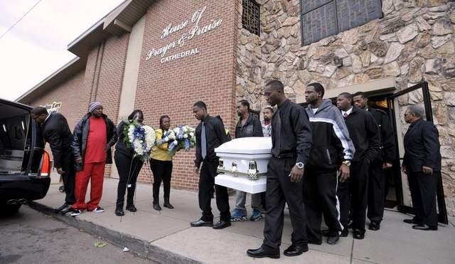 Pallbearers carry Renisha McBride to her final rest.