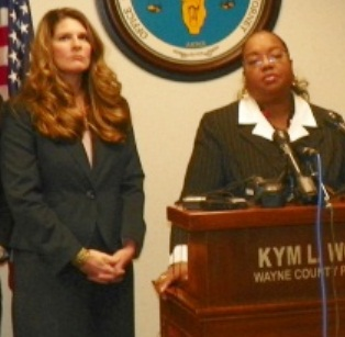 Asst. Prosecutor Danielle Hageman-Clark with Prosecutor Kym Worthy during announcement of charges against Wafer.