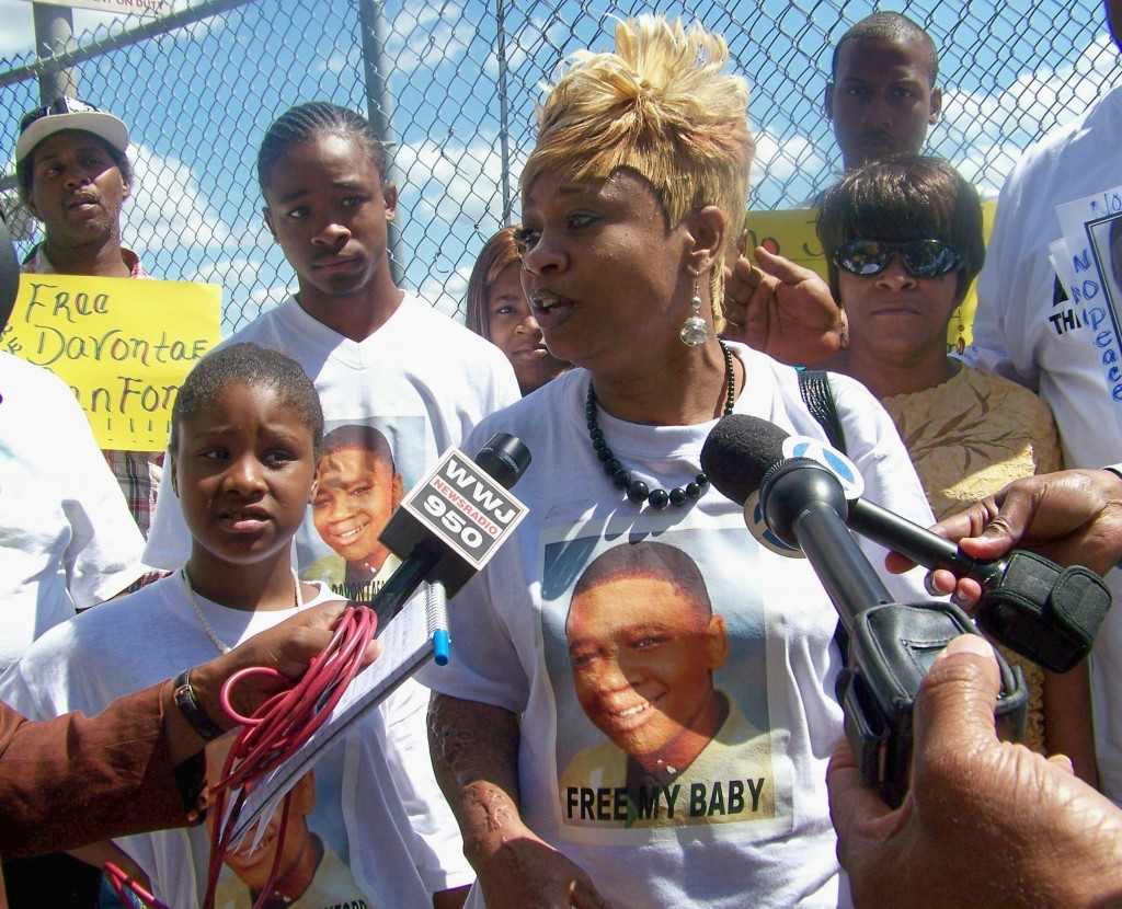 Taminko Sanford-Tilmon is interviewed at rally for her son Davontae outside Frank Murphy Hall June 29, 2010.