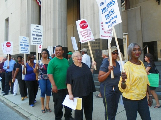 City retirees and their supporters protest outside federal court in downtown Detroit during bankruptcy hearing Aug. 19, 2013.