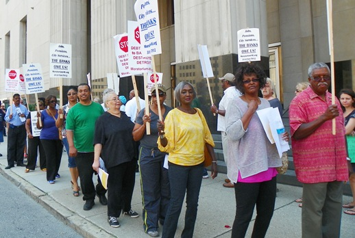 Detroit retirees protest outside bankruptcy hearing.