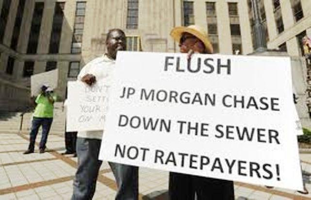 Protesters in Birmingham, Ala. call for cuts to JP Morgan Chase debt, not increases in sewer rates, as part of bankruptcy proceedings for Montgomery County, ALA. The Plan of Adjustment involves both a 75 percent cut in Chase's debt as well as increased sewer rates.
