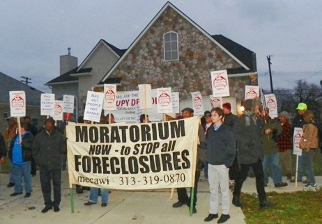Occupy Detroit and Moratorium NOW rally to stop foreclosure at Detroit woman's home Dec. 6, 2011.