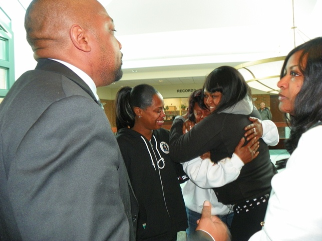 Renisha McBride's mother Monica McBride (center) is consoled by the teen's friend after the verdict Dec. 19, 2013. Her father Walter Ray Simmons is at left.