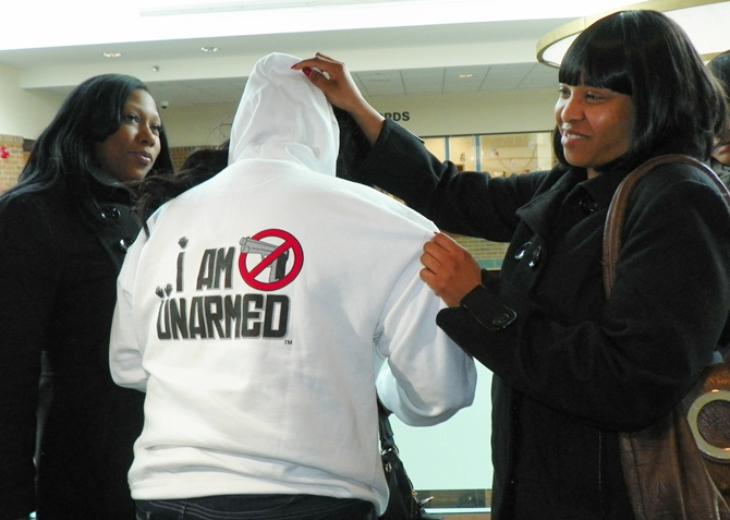 Renisha McBride's friends show one of many hoodies with different slogans that they have had made to demand justice.