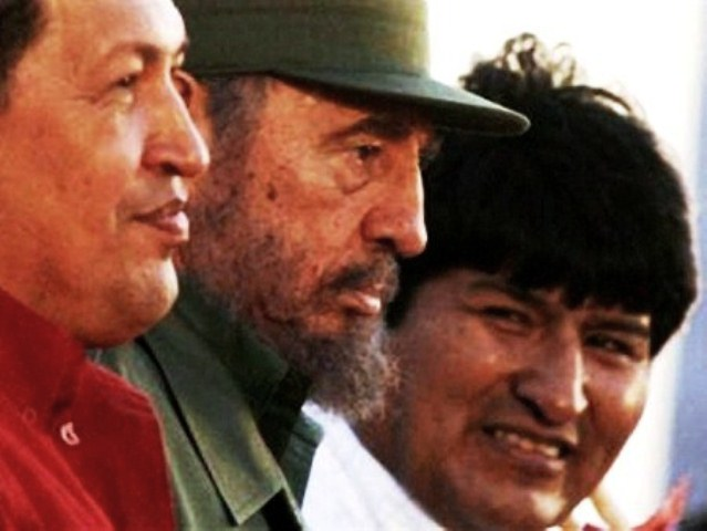 The late Venezuelan Pres. Hugo Chavez, Cuban leader Fidel Castro, and Bolivian President Evo Morales are shown in Havana. Pres. Morales confronted a European Union conference with a stunning demand for reparations. (See link to his speech below.)