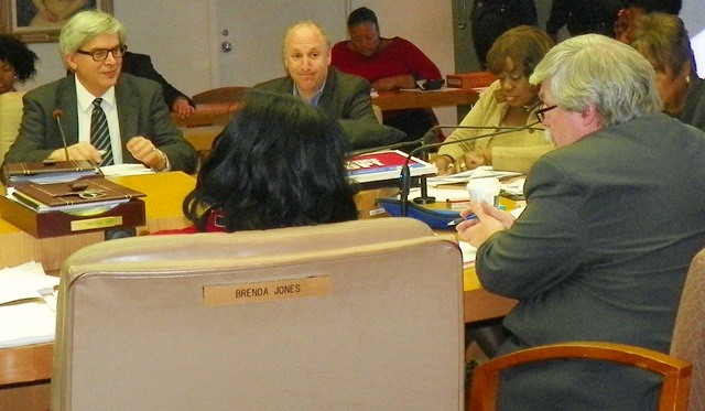 Ted Phillips of UCHC (r) testifies at Council hearing Nov. 19, 2013 as developers across the table smile approvingly.