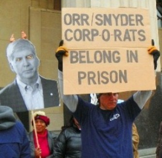 Protester at bankruptcy court Oct. 28, 2013