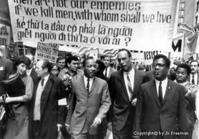 Dr. Martin Luther King, Jr. marches against genocidal U.S. war on Vietnam.