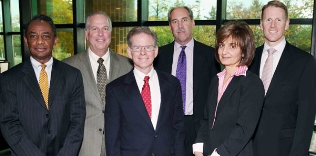 """Judge Steven Rhodes """"chaired"""" a one-sided forum on EM's and Chapter 9 bankruptcy Oct. 10, 2012. (L to r) Frederick Headen, State Treasury Official who has been instrumental in over a dozen municipal and school takeovers; Edward Plawecki, Judge Rhodes, Douglas Bernstein and Judy ONeill. both trainers of EM's, with O'Neill a co-author of EM Public Act 4,  Charles Moore of Conway McKenzie, a chief witness for Orr in trial before Rhodes. Rhodes refused to recuse himself after VOD editor Diane Bukowski demanded he do so."""
