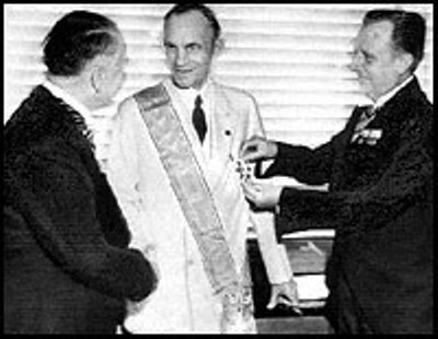 German diplomats award Henry Ford, center, with their nation's highest decoration for foreigners, the Grand Cross of the German Eagle, in July 1938. (AP Photo)