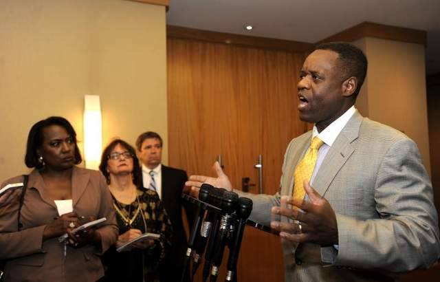 (L to r) Jounalists Vickie Thomas of WWJ and Diane Bukowski of Voice of Detroit question Kevyn Orr after meeting with creditors June 14, 2013.