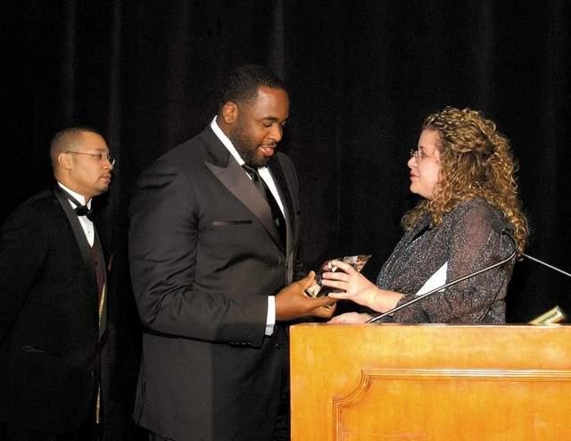 Former Detroit CFO Sean Werdlow and former Mayor Kwame Kilpatrick accept Bond Buyer award for POC deal.