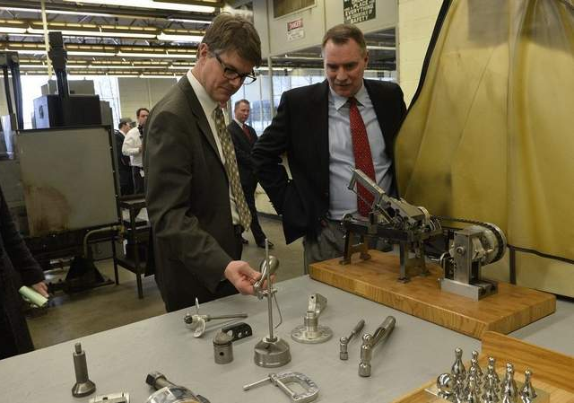 State Rep. Joe Haveman and Andy Ribbens, president of Premier Finishing in Grand Rapids, look over some of the products created by prisoners in the machines shop at the Richard Handlon Correctional Facility. A press conference was held at the facility Wednesday to discuss bills aimed at reducing the state's 78-percent employment rate for parolees.