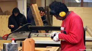 Youth at alternative prison woodworking shop in Germany.