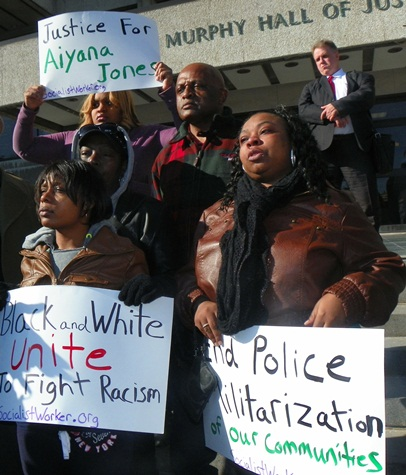 LaKrystal Sanders is at right in this photo of Aiyana Jones family at rally in March, 2013. Her mother Dominika is at left, with grandmother Mertilla Jones behind her, and Aiyana's maternal grandfather Jimmie Stanley at top.