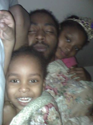 Charles Jones asleep with his children; Aiyana is at right. Family Facebook photo