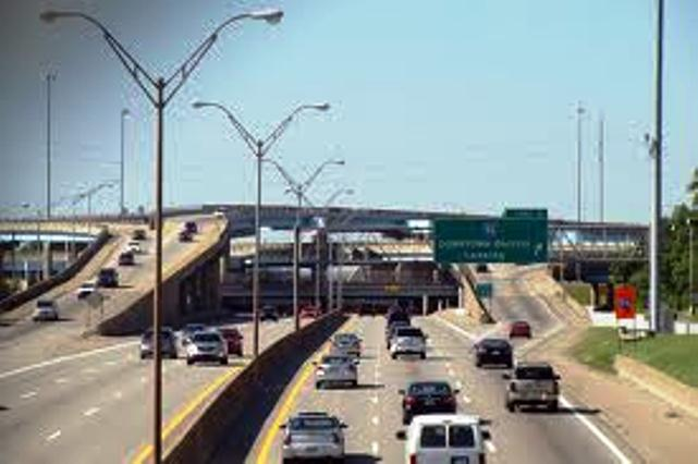 Detroit freeway interchange; half of Detroit's drivers cannot afford car insurance according to studies.