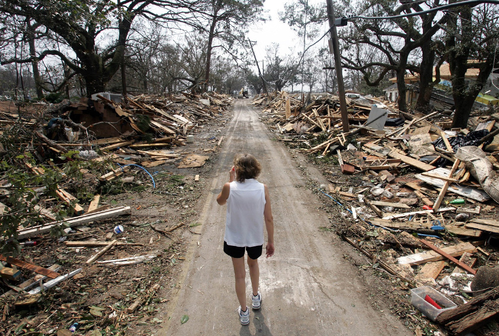 Little girl in shock after the destruction Hurricane Katrina wrought on New Orleans. A good number of Detroit's neighborhoods resemble this photo now after massive illegal foreclosures and evictions by the banks.