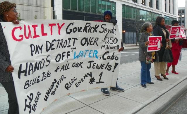 Protest against Snyder appearance in Detroit targets PA 4, then on the ballot as Prop 1. It was soundly defeated, but replaced by Snyder and the legislature with PA 436.
