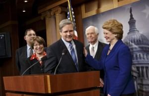 Senate Agriculture Committee Chairwoman Debbie Stabenow, D-MI, right, Thad Cochran, R-MS, second from right, and Senator John Hoeven, R-ND, center, just after Congress gave its final approval to the sweeping five-year farm bill, Tuesday, February 4, 2014. At left are Senator John Boozman, R-Ark., and Senator Amy Klobuchar, D-MN.  (AP Photo/J. Scott Applewhite)