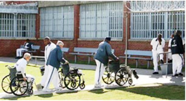 Prisoners being wheeled back into geriatric unit.