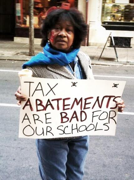 Woman in Philadelphia protests tax abatements. Michigan's PA 210 indicates that money is taken from the state school aid fund and other sources to provide tax abatements.