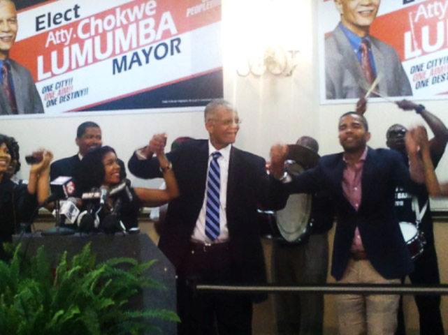 Mayor Chokwe Lumumba celebrates election victory June 5, 2013 with his daughter Rukia at his right and son Chokwe Antar at right. There is a move on to have his son replace him as mayor.