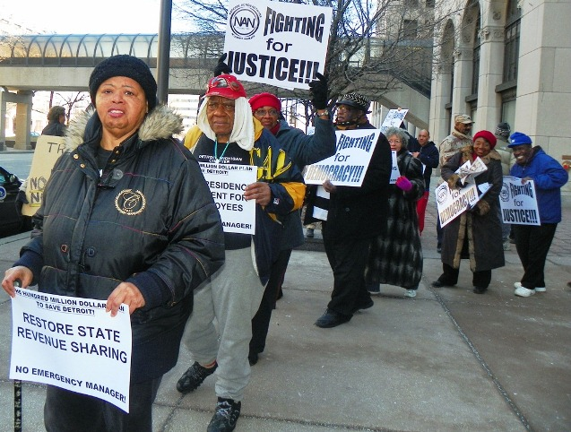 Protester Sandra Hines demands restoration of state revenue sharing to Detroit during protest at Cadillac Place State Bldg. March 4, 2013.