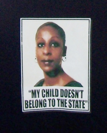 Maryanne Godboldo's photo on front of T-shirt, part of campaign to stop state theft of children, particularly from poor communities and those of color