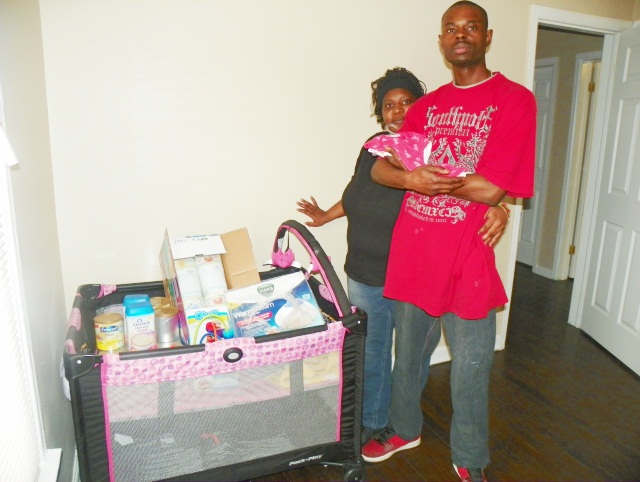 Tamikio and dad with Atjamino baby supplies