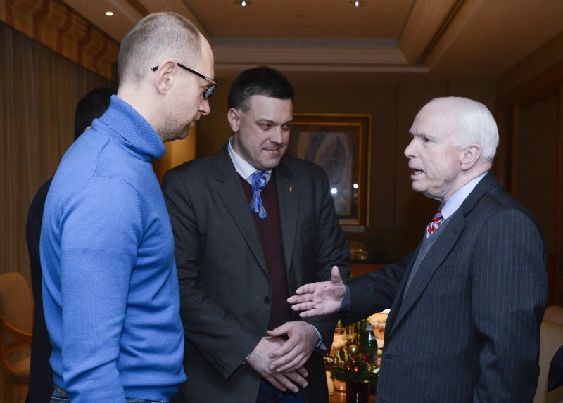 U.S. Senator John McCain, right, meets Ukrainian opposition leaders Arseniy Yatsenyuk, left, and Oleh Tyahnybok in Kiev, Ukraine, Saturday, Dec. 14, 2013.