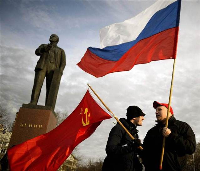 Crimean supporters of Russia demonstrate in front of statue of Vladimir Lenin, the leader of the Soviet Communist revolution.