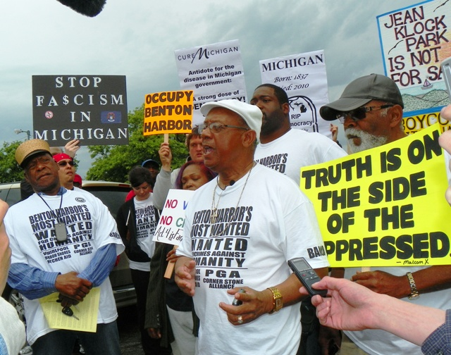 Rev. Edward Pinkney (center) leads rally against Whirlpool-sponsored PGA tournament in Benton Harbor May 26, 2012