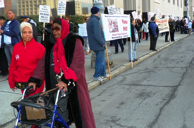 Retirees protest cuts outside bankruptcy court April 1, 2014.