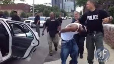 Youth arrested by Detroit police; they also arrested Freep photographer Mandi Wright.