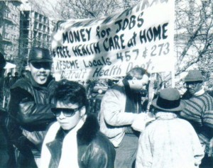 AFSCME Locals 457 and 273 from the now defunct Detroit Health Dept. marched in Washington against the first U.S. war on Iraq in 1991. Local 457 Pres. Al Phillips is at right being interviewed, member Denise Cranford (in hat) listens.