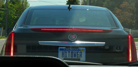 James Hightower's car between two Detroit cars going to visit Rev. Pinkney at his home.