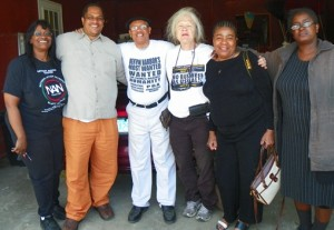 Detroiters Zelma Kinchloe, Cornell Squires, Cindy Darrah, Marcina Cole, and Kim Green visit with Rev. Pinkney at his home after rally.
