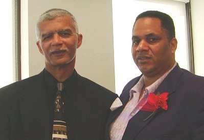 Cornell Squires (r) with his friend, the late Mayor of Jackson, MS. Chokwe Lumumba.