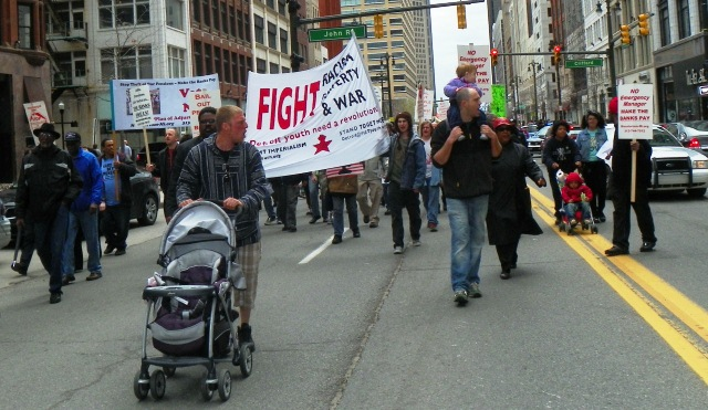 Detroit marchers with their babies take Woodward Ave.