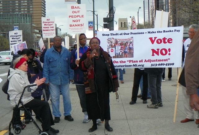 "Councilwoman Emeritus JoAnn Watson speaks at May Day rally  with ""VOTE NO"" on Plan of Adjustment banner behind her."
