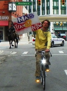 Protester on bicycle.