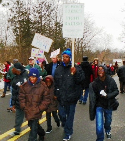 Thousands of marchers descended on Michigan Gov. Rick Snyder's home outside Ann Arbor on MLK Day, 2011 to demand an end to racist EM laws.